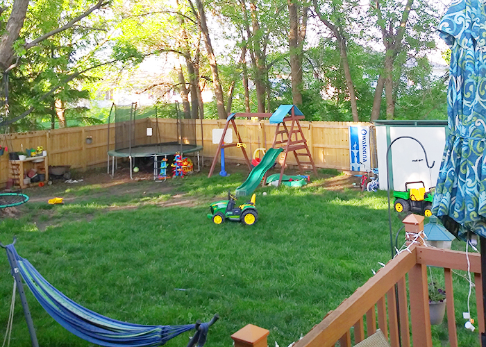 Photo of Kyler's backyard and privacy fence